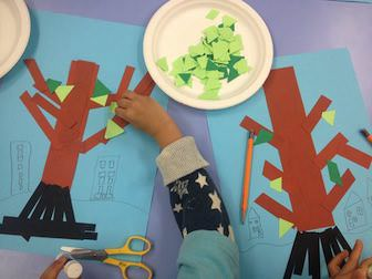 students decorate the tree craft